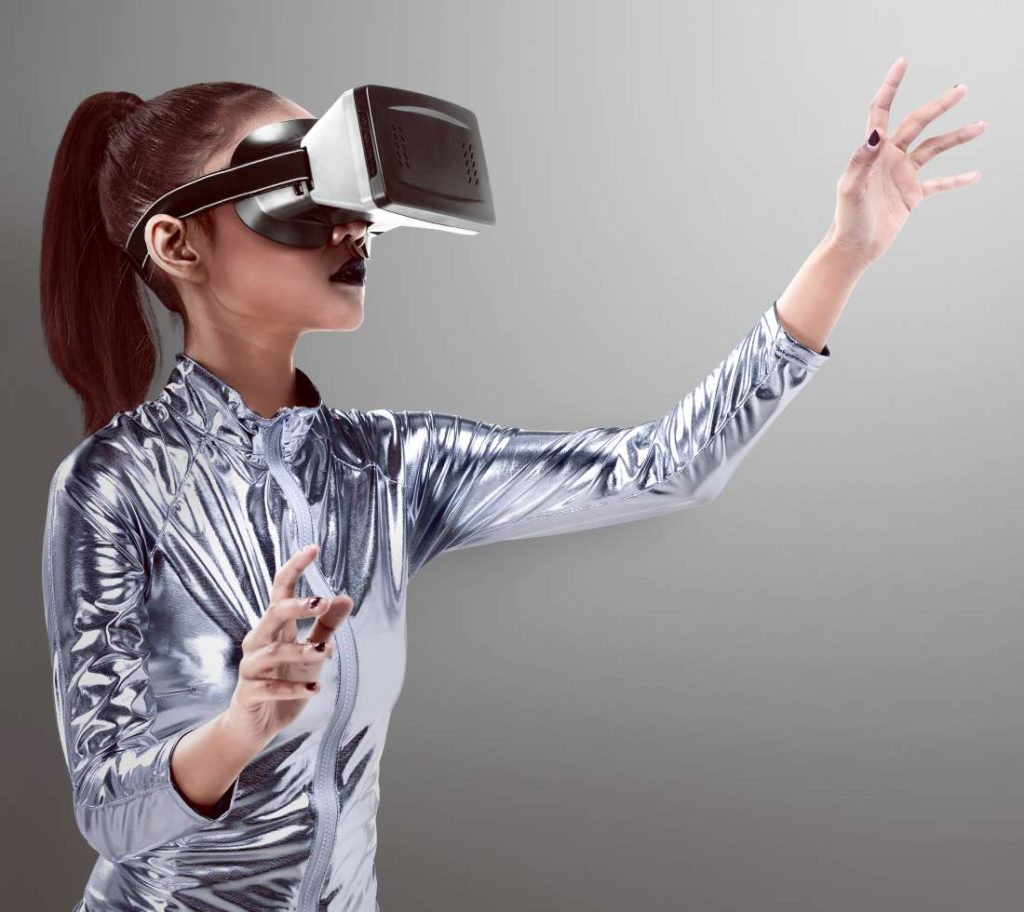 Woman in silver latex costume and VR headset